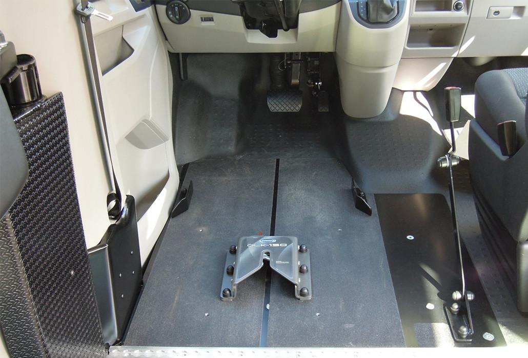 Orthotec-Fahrzeugumbau Rollstuhlsicherung Personensicherung OLK Rollstuhlfixierung